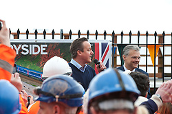© Licensed to London News Pictures. 04/04/2014. Dawlish, Devon, UK. David Cameron thanks 'The Orange army' Engineers. The Riviera Line railway linking Exeter, Plymouth and Penzance reopens two weeks ahead of schedule and two months after a sea wall was breached and a stretch of the line was badly damaged at Dawlish on February 4th 2014  by large waves and storms  which hit much of the British coastline on 4th February 2014. Photo credit : Graham M. Lawrence/LNP