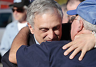Middletown, New York - Republican gubernatorial candidate Carl Paladino hugs a supporter before forum hosted by the Orange/Sullivan County 912 Tea Party in the parking lot outside party headquarters on Oct. 9, 2010.