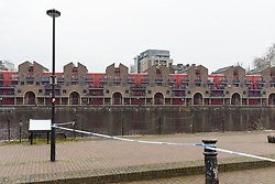 © Licensed to London News Pictures. 21/02/2017. London, UK. Police cordon at the scene after a body was recovered from Shadwell Basin in east London today. Police were called at approximately 10:30hrs on Wednesday, 21 February to reports of a body in the water at Shadwell Basin, E1. The body, a woman believed aged in her 40s, was recovered from the water. Photo credit: Vickie Flores/LNP