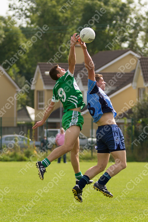Kildysart's Neil O'Connor and Wolfe Tones Brian O'Connell both jump for the ball