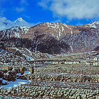 Khunde & Khumjung (background), leading towns of the Sherpa people in Nepal's Khumbu region.  Mount Thamserku on left.  This photo was taken in 1979, before the explosion of mountaineering and trekking activity in the region.