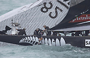 A crewmember is hauled back aboard NZL82 after the dismasting in leg three of race four of the America's Cup 2003. 28/2/2003 (© Chris Cameron 2003)