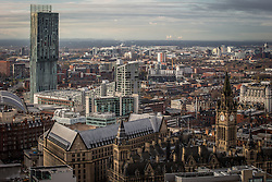 © Licensed to London News Pictures . 07/12/2013 . Beetham Tower (left), Manchester Town Hall (right) and Fiddlers Ferry coal fired and biomass power station in Cuerdley , Cheshire on the horizon . Cityscape view of Manchester . Photo credit : Joel Goodman/LNP
