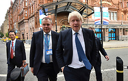 © Licensed to London News Pictures. 02/10/2017. Manchester, UK. Foreign secretary BORIS JOHNSON (right) seen at the second day of the Conservative Party Conference. The four day event is expected to focus heavily on Brexit, with the British prime minister hoping to dampen rumours of a leadership challenge. Photo credit: Ben Cawthra/LNP