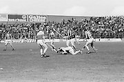 A Wexford player sprawled out on the pitch after a tackle during the All Ireland Senior Leinster Hurling Final Kilkenny v Wexford at Croke Park on the 24th of July 1977. Wexford 3-17 Kilkenny 3-14.