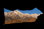 A natural window in a boulder pile in the Alabama Hills near Lone Pine, California, frames several Sierra Nevada peaks, including Lone Pine and Mount Whitney. Mount Whitney, at right, is the tallest mountain in the 48 contiguous United States, with an elevation of 14505 feet (4421 m).