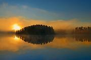 Fog at sunrise at Isabel Lake<br /> Kenora<br /> Ontario<br /> Canada
