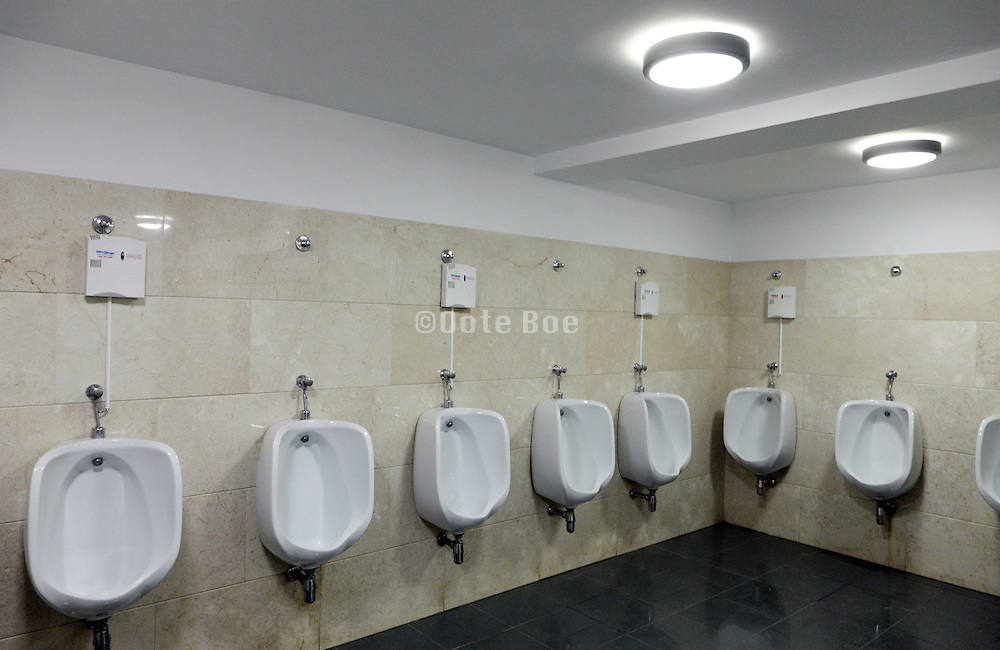row with urinals at a male public toilet