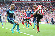 Sunderland midfielder Steven Pienaar (20)  with a cross  during the Premier League match between Sunderland and Middlesbrough at the Stadium Of Light, Sunderland, England on 21 August 2016. Photo by Simon Davies.