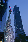 This replica of the Statue of Liberty sits outside of a Starbucks Coffee. It is used as an advertisement for soccer.