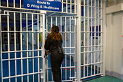 A female Prison Officer locks the metal gate entrance to D Wing and Healthcare Wing of Her Majesty's Prison Pentonville, London, United Kingdom. (Photo by Andy Aitchison)