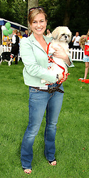 EMMA FORBES with her dog Alfie at the Macmillan Cancer Relief Dog Day held at the Royal Hospital Chelsea South Grounds, London on 6th July 2004.