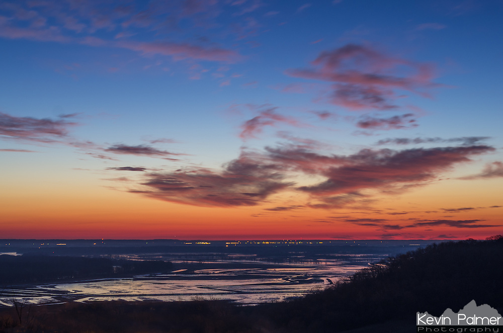 After watching the Geminid meteor shower, I was treated to a great sunrise over the Mississippi River. It was especially colorful during twilight. The flooded area is part of Ted Shanks Wildlife Area with the river to the left.<br />