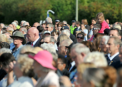 © licensed to London News Pictures. CARTERTON, UK.  01/09/11. Crowds at  the event. A ceremony, attended by British Prime Minister David Cameron,  takes place at The Memorial Garden at Norton Way in Carterton, Oxfordshire today (01 Sept 2011). The Garden will become the focal point during the repatriation of UK service personnel from RAF Brize Norton. The Union Flag that used to fly at repatriations in Wooton Bassett was handed over and was blessed. . Mandatory Credit Stephen Simpson/LNP