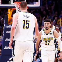 09 April 2018: Denver Nuggets guard Jamal Murray (27) celebrates with Denver Nuggets center Nikola Jokic (15) during the Denver Nuggets 88-82 victory over the Portland Trail Blazers, at the Pepsi Center, Denver, Colorado, USA.