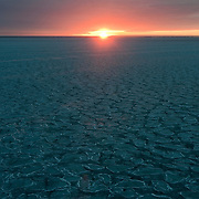 Sunrise over pancake ice forming  on the Beaufort Sea.