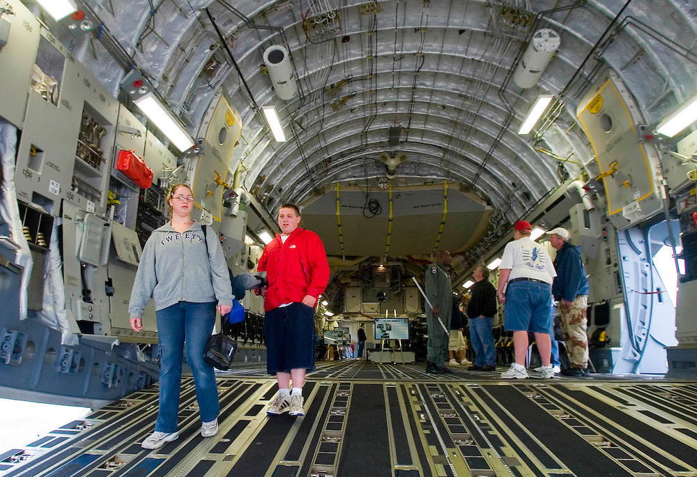 (PSUNDAY) McGuire AFB 6/4/2004  Katie Cook 18 of Jackson and cousin Justin Wydra 16 of Jamesburg check out the inside of a C-17a Globemaster.    EDS:  Due to weather the in air performances were either cancelled or delayed indefinitely until the conditions made it safe to fly. Please also note the crowds were VERY thin.  I did the best I could.   Michael J. Treola Staff Photographer....MJT