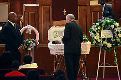 07 September 2013. New Hope Baptist Church. New Orleans, Louisiana. <br /> Archbishop Gregory Aymond attends the funeral service for 1 year old toddler Londyn Unique Reed Samuels, shot to death August 29th.  The infant Londyn was shot by thugs whilst in the arms of her babysitter, the intended victim who was holding Londyn whilst walking down the street at the time of the assault. NOPD has arrested 2 men in connection with the heinous crime.<br /> Photo; Charlie Varley