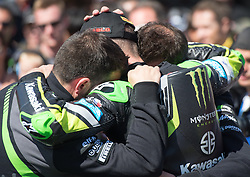February 25, 2018 - Melbourne, Victoria, Australia - British rider Jonathan Rea (#1) of Kawasaki Racing Team is consoled by team mates after finishing 2nd after the second race on day 3 of the opening round of the 2018 World Superbike season at the Phillip Island circuit in Phillip Island, Australia. (Credit Image: © Theo Karanikos via ZUMA Wire)