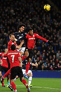 Man Utd's Marouane Fellaini is squeezed out by Cardiff's Ben Turner(l) and Fraizer Campbell ®. Barclays Premier League match, Cardiff city v Manchester Utd at the Cardiff city stadium in Cardiff, South Wales on Sunday 24th Nov 2013. pic by Andrew Orchard, Andrew Orchard sports photography,