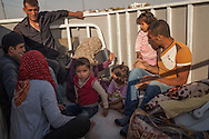 Syrian Kurds from Kobane/Ayn al-Arab arrive in Turkey near Suruç where they are received at a refugee camp for the upwards of estimated 130,000 people to have fled to Turkey from ISIS assaults in the area.