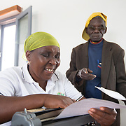 CAPTION: The PWD community faces discrimination on a daily basis. Access to schools, jobs and public services is often limited. Responding to adult literacy challenges by teaching Braille helps ACAMO members to develop active voices for dialogue with the government. It also serves as a method of rehabilitation, building hope for participants that they will eventually be able to return to regular employment and be re-integrated into the mainstream workforce. LOCATION: Lulimile Village, Lichinga, Niassa Province, Mozambique. INDIVIDUAL(S) PHOTOGRAPHED: Anissa Bernado Binamur (left) and Fernando Joaninha (right).