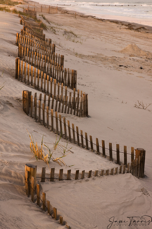 A weather worn sand dune fence zigzags along the Jersey shore,Stone Harbor,New Jersey,USA