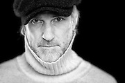 Black and white portrait of Paul taken in a Bristol studio against a black background by creative portrait photographer Jonathan Bowcott.