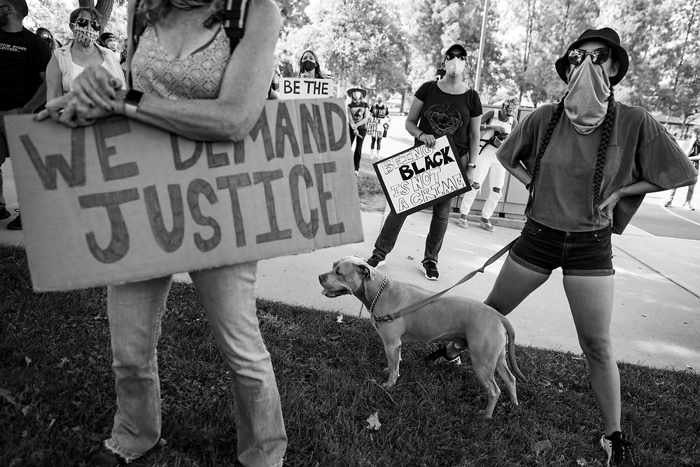 Nicole Walton, right, with her Pit Bull, Opie, protests at a Black Lives Matter demonstration in Simi Valley, a conservative, predominantly white suburb of Los Angeles, on Juneteenth.