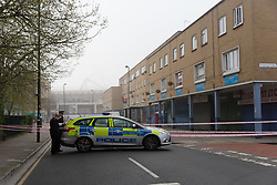 © Licensed to London News Pictures. 03/04/2017. LONDON, UK.  Police officers and a police car at the crime scene and police cordon around BJ Wines and parade of shops in Freemasons Road, Canning Town, east London. Ahmed Jah, 21 is reported to have been knifed inside the off license, BJ Wines in Freemasons Road yesterday afternoon after he was set upon by a gang of men and stabbed in the chest. Emergency ambulance services attended and the man was pronounced dead at the scene shortly after.  Photo credit: Vickie Flores/LNP