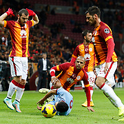 Galatasaray's Yekta Kurtulus (L) Felipe Melo (C) during their Turkish superleague soccer derby match Galatasaray between Trabzonspor at the AliSamiYen spor kompleksi TT Arena in Istanbul Turkey on Saturday, 22 November 2014. Photo by Aykut AKICI/TURKPIX