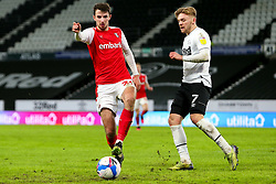 Dan Barlaser of Rotherham United clears the ball from Kamil Jozwiak of Derby County in a dangerous area - Mandatory by-line: Ryan Crockett/JMP - 16/01/2021 - FOOTBALL - Pride Park Stadium - Derby, England - Derby County v Rotherham United - Sky Bet Championship