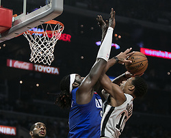 November 15, 2018 - Los Angeles, California, U.S - Montrezl Harrell #5 of the Los Angeles Clippers tries to stop DeMar DeRozan #10 of the San Antonio Spurs during their NBA game on Thursday November 15, 2018 at the Staples Center in Los Angeles, California. Clippers defeat Spurs, 116-111. (Credit Image: © Prensa Internacional via ZUMA Wire)