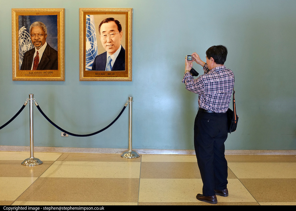 © Licensed to London News Pictures. 27/05/2012. New York, USA. A chinese tourist takes a photograph of Former UN Secretary-General Kofi Anan (L) and the current UN Secretary-General Ban K-Moon at The United Nations  in New York,  today 27 May 2012.  Photo credit : Stephen Simpson/LNP