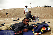 Recruits are exercising at a long-range shooting ground at the Shaheed Benazir Bhutto Elite Police Training Center, a commando and anti-terrorism academy on the outskirts of Karachi. The training center was founded by retired colonel Abdul Wahid Khan, a brave officer who served as a gunship helicopter pilot in the Pakistani Air Force and around the globe with the United Nations, but who's first task as a young army officer in 1979 was to train Afghan Mujahedeen to fight the Soviet Army, the very Mujahedeen that are today's Taleban.