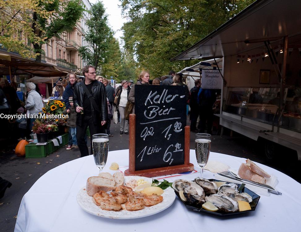 table with shrimps and fresh oysters at weekend street market on Kollwitzplatz in bohemian Prenzlauer Berg in Berlin