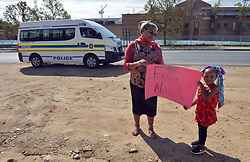 140418 Johannesburg. Winnie Madikizela-Mandela funeral.  Granny Muriel Mvana and grand-daughter Bomkazi(3) from Sunninghill show a poster to passing cars in anticipation of the funeral motorcade to come past on Witkoppen road, Fourways. Picture: Karen Sandison/African News Agency (ANA)