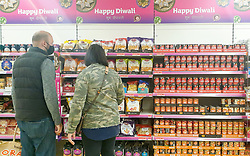 © Licensed to London News Pictures. 09/10/2020. London, UK. Shoppers wearing face masks view items for Diwali as Sainsbury's stock for the Festival of Light. This year Diwali falls on Saturday, 14 November. Diwali is the five-day festival of lights, celebrated by millions of Hindus, Sikhs and Jains across the world. It's a a festival of new beginnings and the triumph of good over evil, and light over darkness. Photo credit: Dinendra Haria/LNP