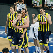 Fenerbahce's players celebrate victory during their Turkish Basketball Legague Play-Off semi final second match Efes Pilsen between Fenerbahce at the Sinan Erdem Arena in Istanbul Turkey on Friday 27 May 2011. Photo by TURKPIX