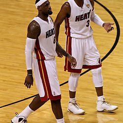 Jun 21, 2012; Miami, FL, USA; Miami Heat small forward LeBron James (6) and shooting guard Dwyane Wade (3) against the Oklahoma City Thunder during the first quarter in game five in the 2012 NBA Finals at the American Airlines Arena. Mandatory Credit: Derick E. Hingle-US PRESSWIRE