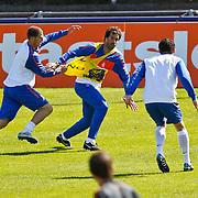 NLD/Katwijk/20100831 - Training Nederlands Elftal kwalificatie EK 2012, Ruud van Nistelrooy in duel met Erik Pieters