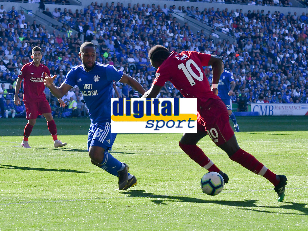 Football - 2018 / 2019 Premier League - Cardiff City v Liverpool<br /> <br /> Sadio Mane of Liverpool on the attack Joe Bennett of Cardiff City, at Cardiff City Stadium.<br /> <br /> COLORSPORT/WINSTON BYNORTH