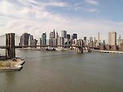 Panoramic view of Brooklyn Bridge with downtown Manhattan in the background.