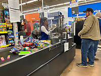 https://Duncan.co/walmart-employee-behind-protective-barrier