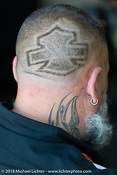 Harley-Davidson employee with the bar and shield logo shaved on his scalp during the 78th annual Sturgis Motorcycle Rally. Sturgis, SD. USA. Saturday August 11, 2018. Photography ©2018 Michael Lichter.