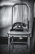 A dialless bedside phone sit on a chair in the historic Hotel Geneva.