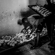 Employees at the bakery, Breadline, prepare bread for customers at the bakery in Khartoum, Sudan on December 13, 2020. More affluent customers can come to this non-government subsidized bakery to avoid the long wait times. Two years after a revolution gave way to the end of Omar al-Bashir's 30-year rule, the new government inherited a bankrupt state, burdened by the consequences of international sanctions. Although assisted by the World Bank and the IMF, the country remains mired in the economic crisis.  Byron Smith for Libération