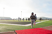 The Iraan High School football team goes through their final walkthrough before getting on the busses to Arlington for their state title game in Iraan, Texas on December 14, 2016. (Cooper Neill for The New York Times)