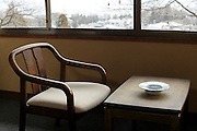 Japanese hotel room in the morning with chair by the window