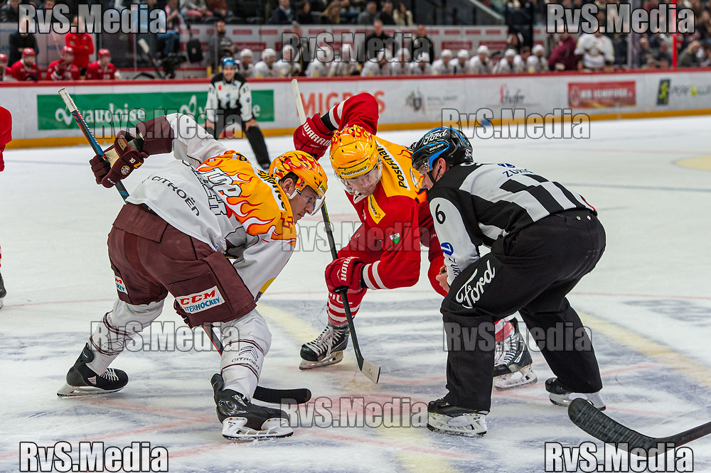 LAUSANNE, SWITZERLAND - NOVEMBER 23: TopScores on the face-off on the left #10 Tommy Wingels of Geneve-Servette HC and on the right #15 Dustin Jeffrey of Lausanne HC during the Swiss National League game between Lausanne HC and Geneve-Servette HC at Vaudoise Arena on November 23, 2019 in Lausanne, Switzerland. (Photo by Robert Hradil/RvS.Media)